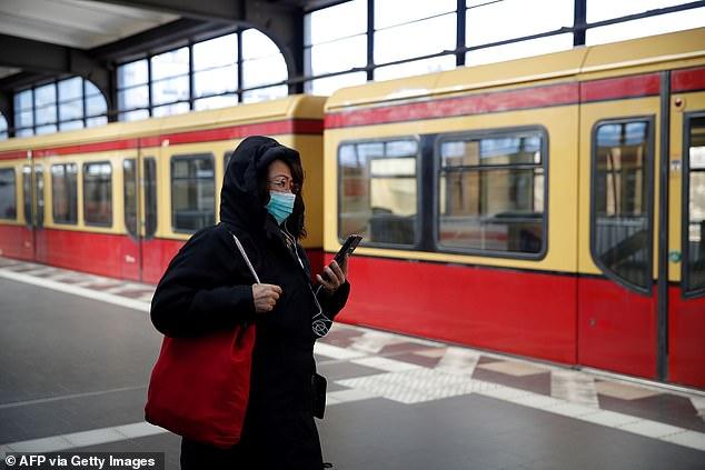Woman wears facial mask on public transport in Berlin, March 23, 2020 (photo)