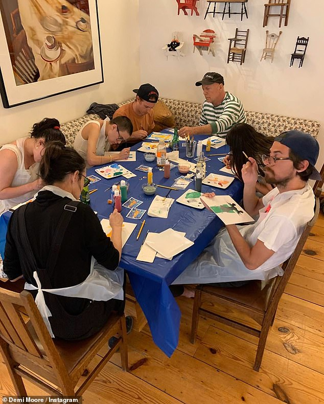 Artists: Demi Moore, 57, revealed she and her ex-husband Bruce Willis, 65, had a painting party with the whole family in photos posted on Instagram Tuesday as they quarantined together