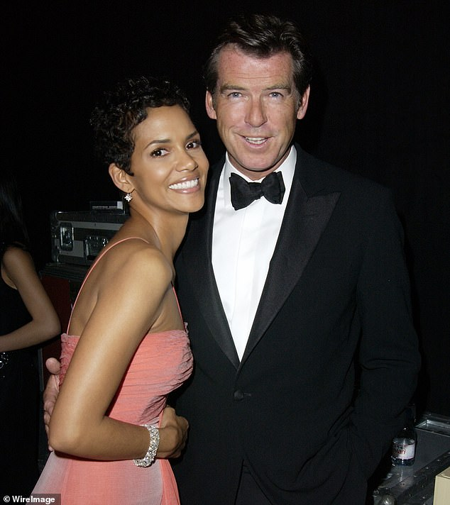 Lifesaver: Halle added: 'James Bond knows how to Heimlich! He was there for me, he will always be one of my favorite people in the whole world.' Halle and Pierce are pictured in 2003