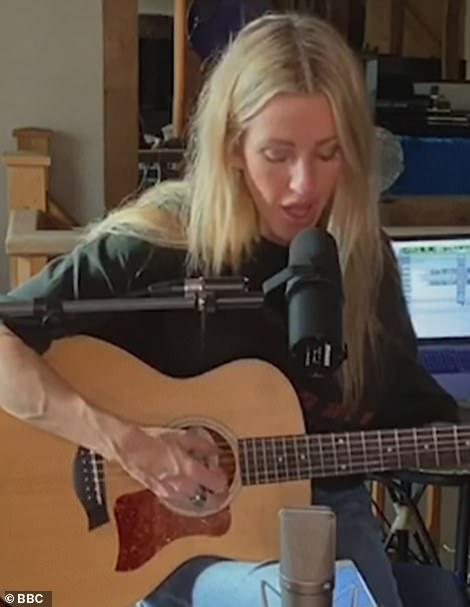 Multi-talented: Starry Eyed singer Ellie Goulding, 33, picked up her guitar