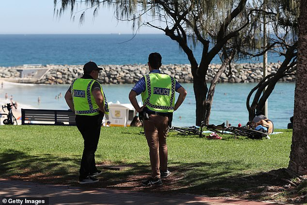 A police officer has revealed the bizarre questions his station has been asked during the coronavirus pandemic. Pictured: Police patrol Cottesloe Beach in Perth