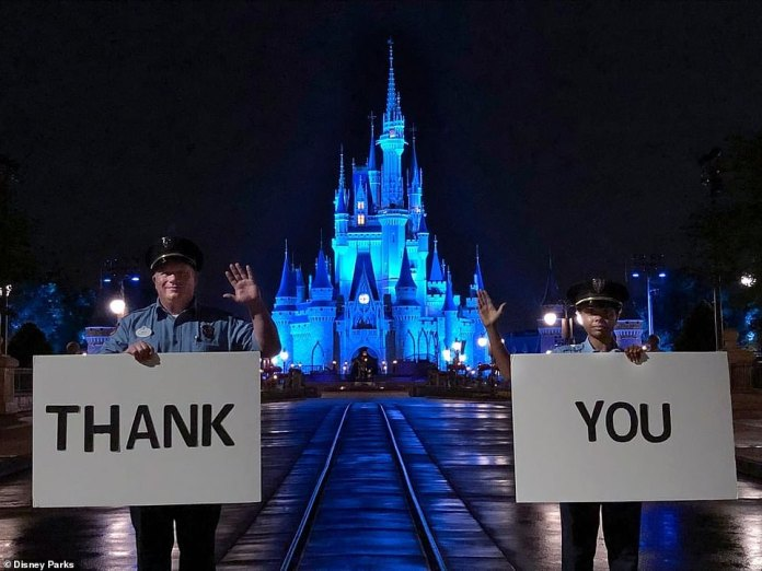 The Magic Kingdom theme park at Walt Disney World in Florida, closed since mid-March. Last week, Cinderella's castle was lit up in blue to honor health care workers