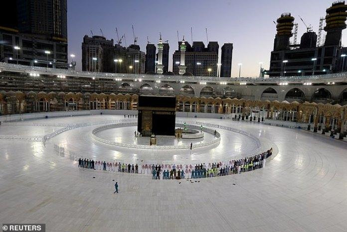 Worshippers perform Taraweeh prayer at Kaaba in the Grand Mosque on the first day of the holy month of Ramadan during the outbreak of coronavirus - a far cry from the huge crowds usually seen in the central courtyard