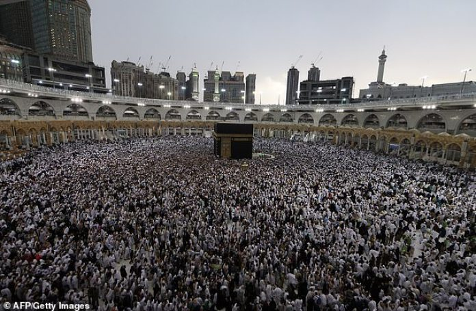 Above, Muslim worshippers gather around the cuboid Kaaba, during Ramadan in May 2019. This year will see a far emptier courtyard area as Muslims stay indoors