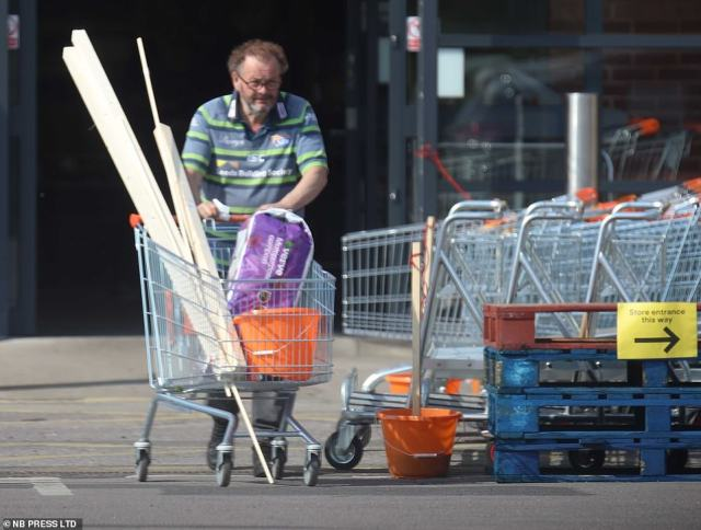Some at DIY stores pushed trolleys filled with rolls of carpet while others were seen lifting enormous products into their cars. Pictured: One shopper at B&Q in York