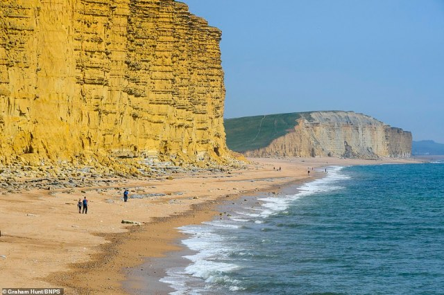 The famous sandstone cliffs in West Bay in Dorset were largely deserted, but some walkers still took advantage of the beautiful weather