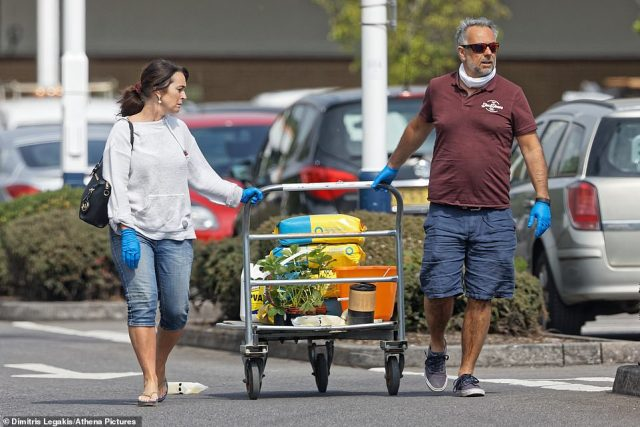 Some people wore protective clothing, including one couple who were wearing blue rubber gloves as they pulled a trolley holding various DIY  items, as well as a potted plant