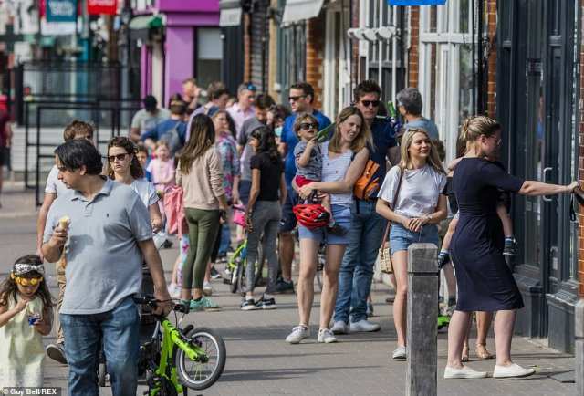 Crowded: A queue formed to buy ice cream in Battersea, South West London, as people sought to make the most of the good weather