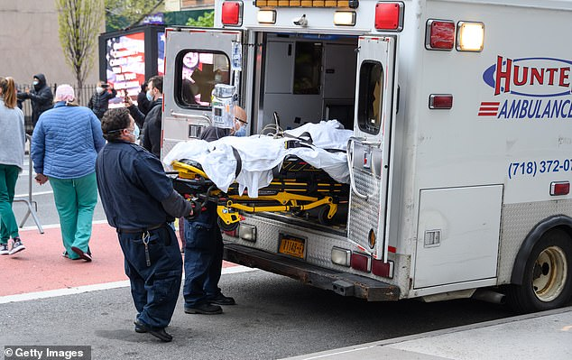 The state of New York is the centre of the outbreak in the U.S. In the picture taken on Monday,EMS workers wheel a patient outside NYU Langone Health hospital during the crisis