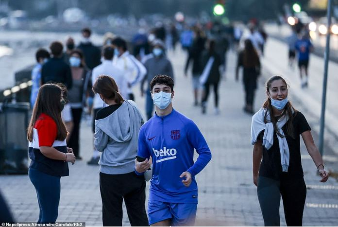 Joggers are seen along Lungomare - Naples' seaside promenade - Tuesday morning after Italy began to loosen its lockdown measures
