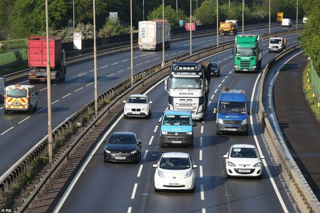Cars, vans and lorries on the M4 motorway (right hand lane is inbound towards London) at Datchet in Berkshire this morning