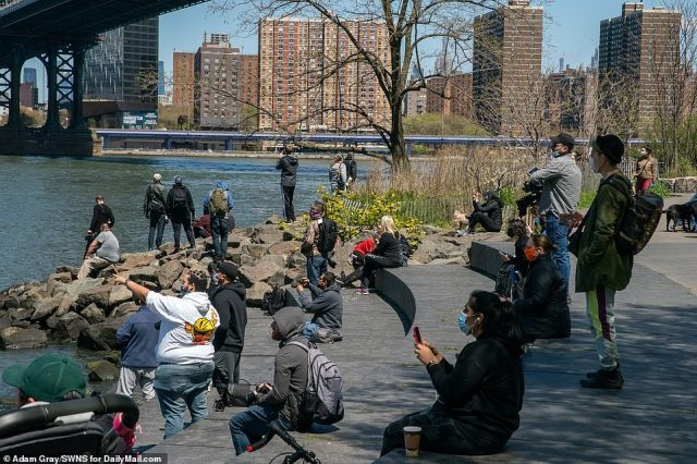 Brooklyn Bridge Park, New York:Others noted the crowds that gathered earlier Tuesday to watch a flyover by the Navy´s Blue Angels and the Air Force´s Thunderbirds to honor health-care workers but were not similarly treated by officials