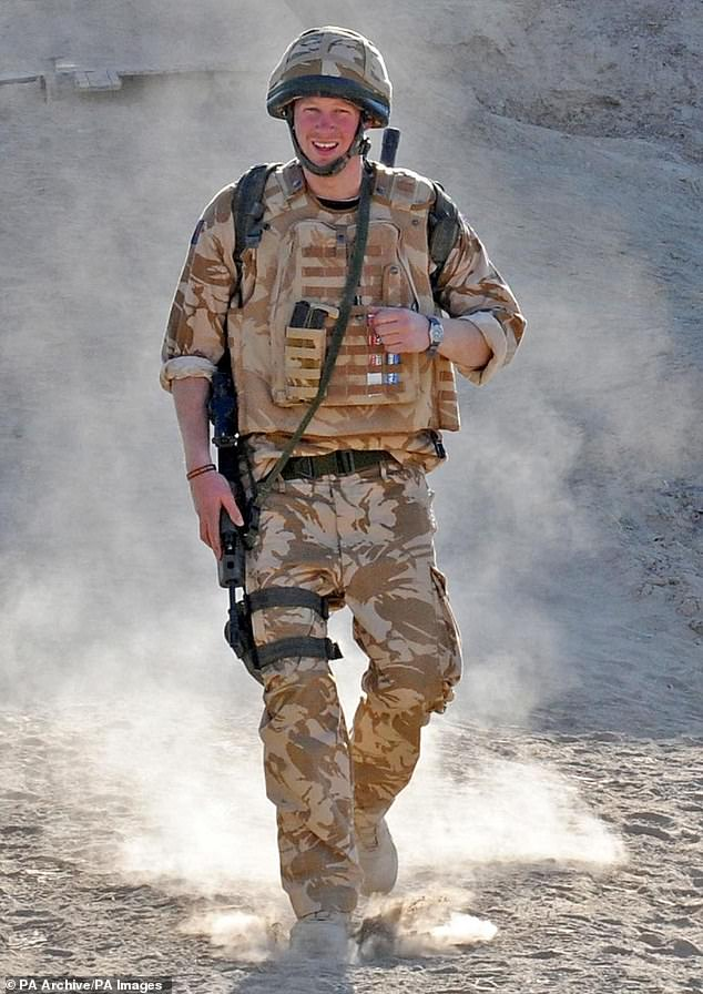 Prince Harry patrols the deserted town of Garmisir while posted in Helmand Province in Southern Afghanistan