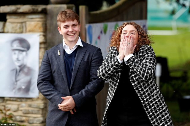 The family of army veteran Captain Tom Moore, daughter Hannah Ingram-Moore and grandson Benji react outside his home on his 100th birthday