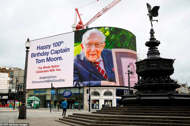 A birthday message for Captain Tom Moore is displayed on the advertising boards in Piccadilly Circus in London this morning