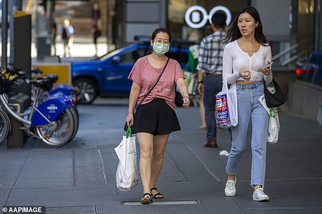A shopper is seen wearing a mask in Brisbane, Friday, May 1, 2020