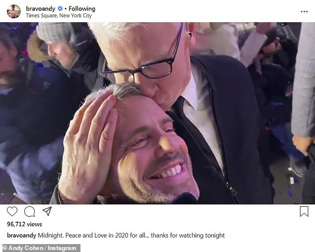 'Midnight': Andy and Anderson are pictured bringing in 2020 together during a live broadcast in Times Square for CNN