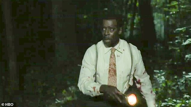 Everyday dangers: 'This place... is dangerous,' George intones over scenes of Atticus and Letitia being assaulted by white police officers deep in the woods at night