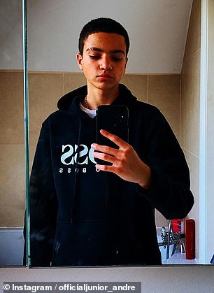 Friday night, Junior took a photo of the bathroom mirror while wearing a Hugo Boss hoodie at Surrey's family home, and his famous father couldn't resist comparing his look to moody rapper Eminem