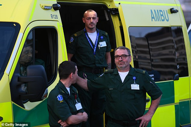 In the afternoon, I discover that we've run out of the forms we use to inform colleagues that a patient is not to be resuscitated. Pictured: Members of the Ambulance Service watch on Westminster Bridge on April 23