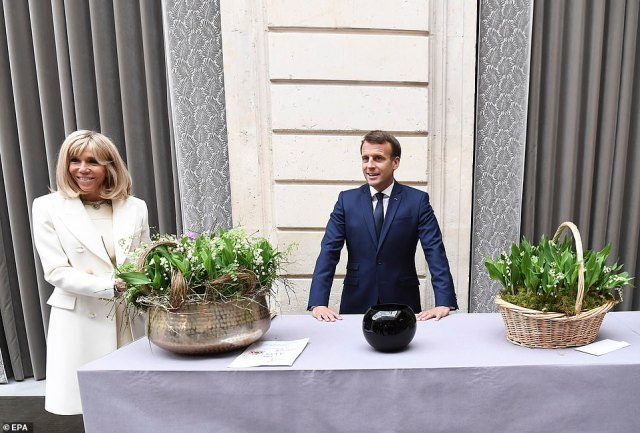 Trust in Macron's (pictured with wife Brigitte at the Elysee Palace) government remained low, with 39 per cent of the French saying they trusted his government to face the coronavirus crisis efficiently, stable from a week ago but down from 55 per cent in March