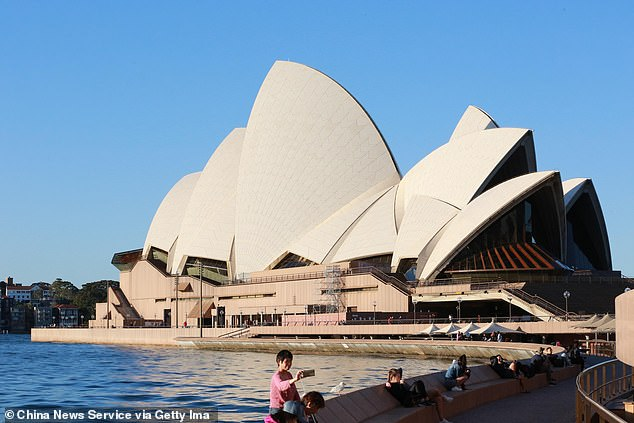 Sightseers outside the Sydney Opera House on Sunday. An expert has warned some Australians may not be able to cope at first with the resumption of normal society