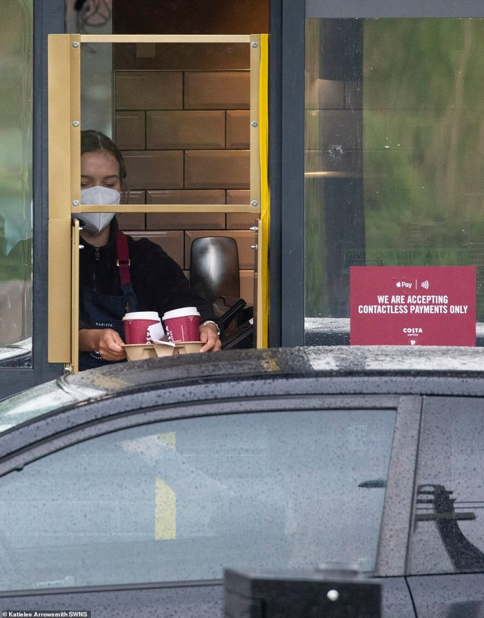 Staff members were masks serving customers of coffee trays at the Edinburgh branch