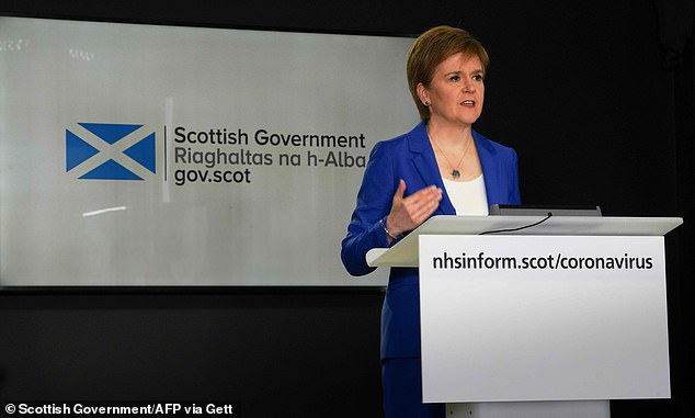 Scotland's First Minister Nicola Sturgeon has said face coverings should be used in enclosed spaces where it is hard to keep a distance from people