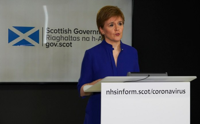 But Nicola Sturgeon, pictured in Edinburgh yesterday, refused to commit to adopting the application in Scotland