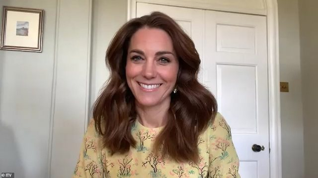 The Duchess of Cambridge has joined forces with the National Portrait Gallery to launch a community photography project designed to capture the 'spirit, mood, hopes and fears' of the nation as it continues to battle coronavirus. Pictured during an interview, which will be broadcast on ITV's This Morning today