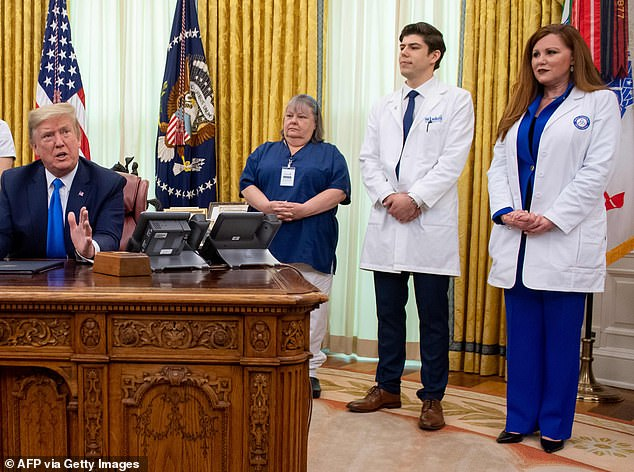 Sophia Thomas (right) told President Trump (left) in the Oval Office on Wednesday that she has been using the same N95 mask `` for a few weeks now ''