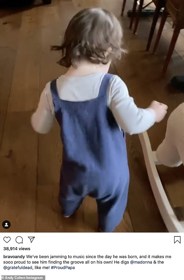 Mini-me: Andy Cohen shows off his 15-month-old son Benjamin Allen love of pop music in adorable Instagram video of him dancing to Madonna's 2005 hit Get Together on Wednesday