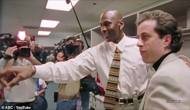 Always watching: Seinfeld is seen shaking hands with Jordan, who introduces the comedian to some Bulls staffers who were 'always watching your show'
