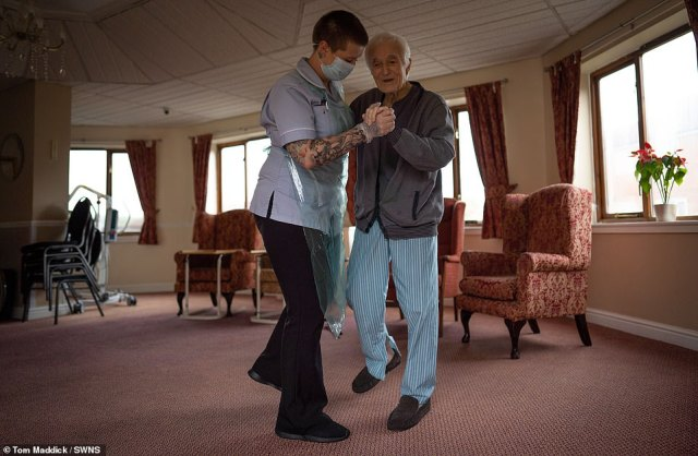 Pictured:79-year-old Jack Dodsley dancing with a health worker at Newfield Nursing Home in Sheffield
