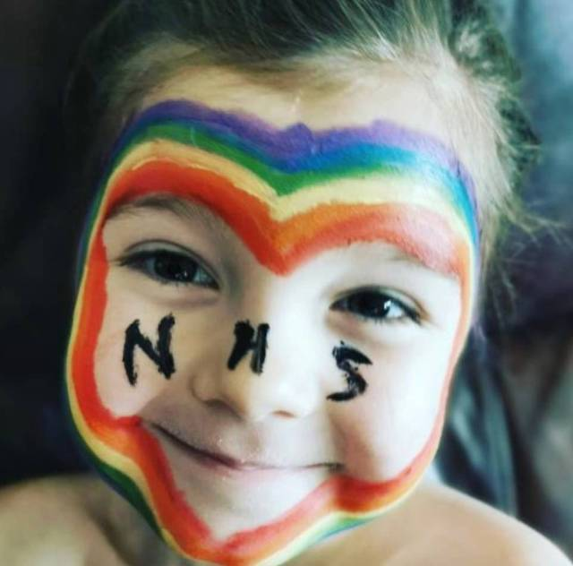 Adorable - Here is a five-year-old girl called Eaddee who wears a painted rainbow face in support of the NHS