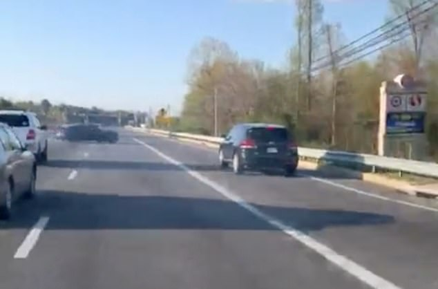 An idiotic driver was spotted losing control and crashing into a barrier while trying to take part in a muscle car race on a suburban highway through Brandywine, Maryland