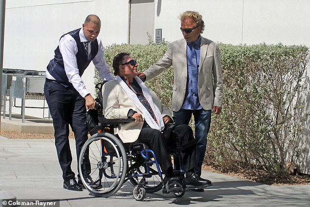 Horn in a wheelchair in 2018 with Siegfried at his side attending the unveiling of a plaque in their honor at the Cleveland Clinic for Brain Health in Las Vegas
