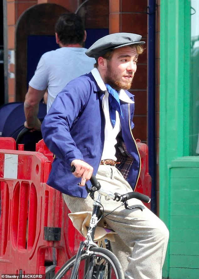 Retro: Madonna and Guy's son looked dapper in a 1940s-style outfit, wearing a waistcoat, tie and flat cap, while wearing untreated strawberry blond facial hair