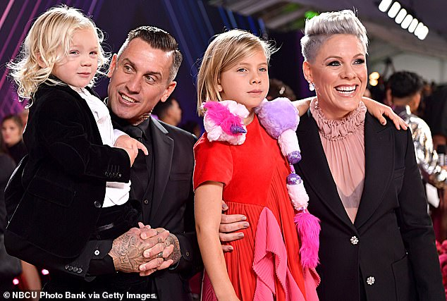 Happy family: she shares her son Jameson and daughter Willow, nine, with husband Carey Hart, 44, whom she married in 2006