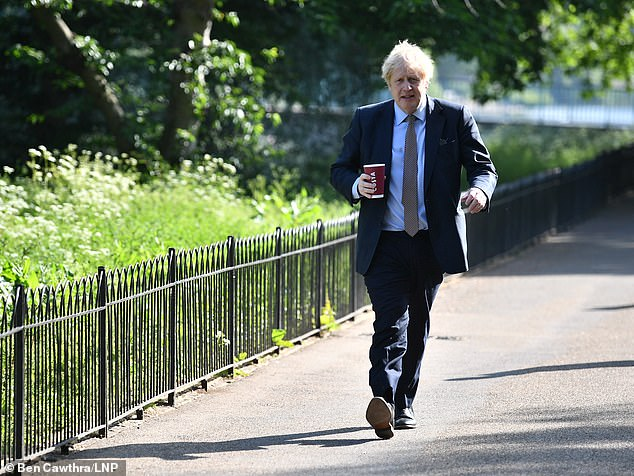 Mr Johnson (pictured in Westminster last week) will use a TV address to the nation at 7pm to announce a DefCon-style five stage alert system to describe the country's outbreak condition