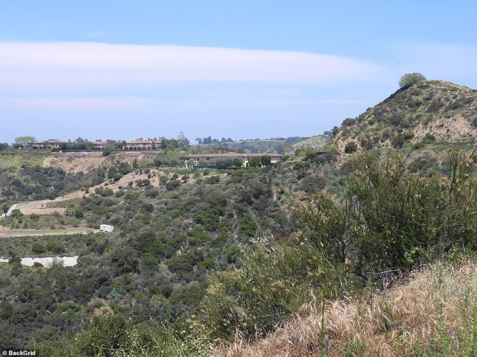 The hilltop property (right) allows people to see the surrounding landscape of the Los Angeles area. The area is elevated above 800 feet