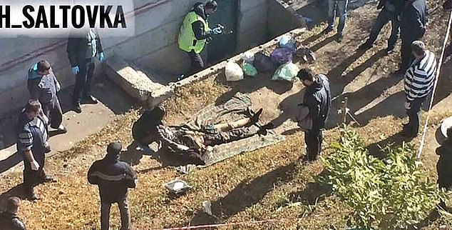 GRAPHIC CONTENT: The headless corpse (pictured) was found dumped near a cellar doorway close to an apartment block in Saltivka, near Kharkiv.