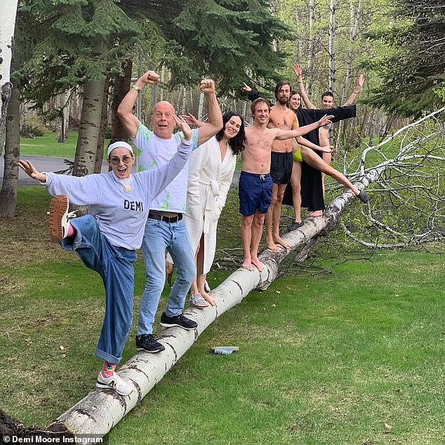 On Friday, Demi posted another family photo of her and her ex Bruce balancing on a tree with their three elders Rumer Scout, 28, and Tallulah, 26.