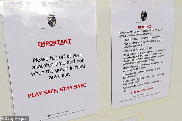 A safety advisory for golfers who are back in action is displayed at the Kirby Muxloe Golf Club in Leicestershire