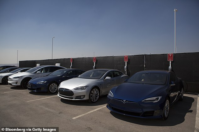Model S vehicles are seen parked outside the Gigafactory outside Reno, Nevada