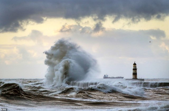 Further down the UK, in County Durham, warm coastal air pressure saw huge waves crash up against Seaham Lighthouse