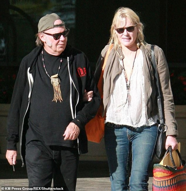 Ouch: Crosby attacked Neil Young's wife, Daryl Hannah, in 2014, calling her `` purely venomous predator, '' but then apologized. Young and Hannah are seen in 2014 above