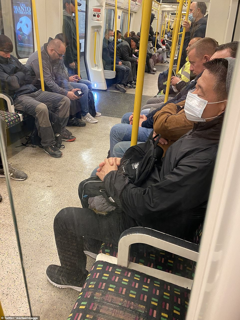 London: Commuter Michael Maggs tweeted this picture of a packed Tube carriage at 6am this morning and said: '@SadiqKhan how we meant to social distance with your terrible service you are running. Had to wait 15 mins to get in this. You are putting lives at risk'.