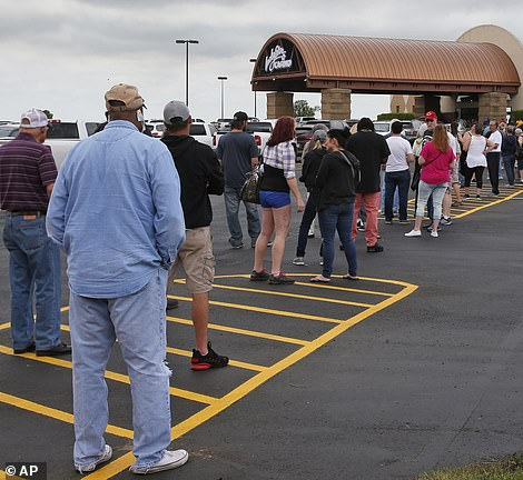 At Lucky Star Casino in Oklahoma, guests and employees received temperatures checks either manually, via thermal imaging camera, or both  Pictured: Customers lined up outside of Lucky Star Casino, May 15