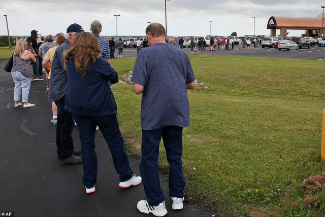 Dozens of gamblers lined up outside casinos in Arizona and Oklahoma as they reopened this week. Pictured: People lined up all the way to the parking lot at the Lucky Star Casino in Concho, Oklahoma, May 15